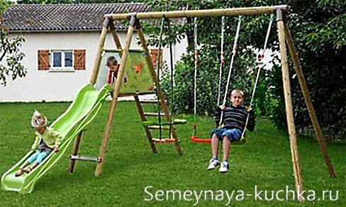 детские деревянные качели с горкой