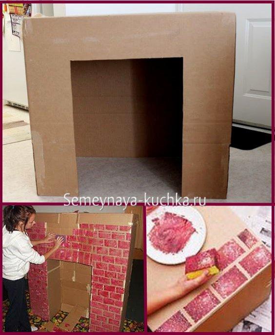 камин из картонной коробки - поделка для офиса на новый год