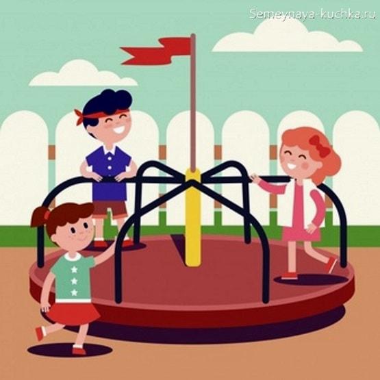 картинка дети катаются на карусели на площадке